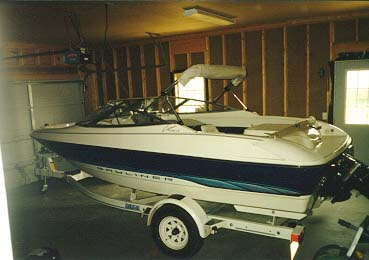 Bayliner 1750 ski boat (parked in garage)