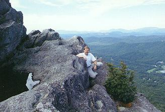me sitting on edge of cliff on Grandfather Mountain